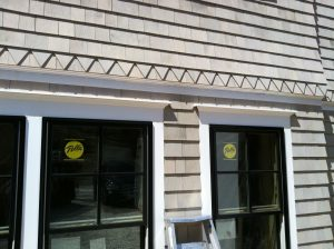 Closeup of custom cedar shingle siding Cape Cod house